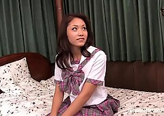 Dreamy Japanese schoolgirl is slowly undressed and caressed for a long time to a magnificent orgasm.