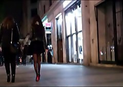 Brunette in mini skirt tights and high heels louboutins