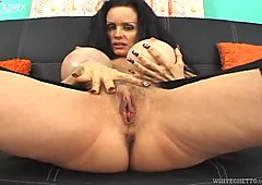 Raunchy slut with giant fake boobs and bearded clam gives stout blowjob