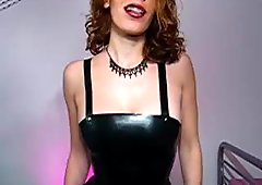 Redhead with braces in a latex dress 2