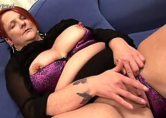 Perv granny stuffing her ass and pussy