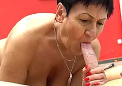 Horny granny seduces young stud to glaze her face