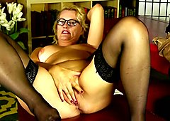Blonde mature lady fingering her pussy