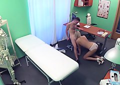 Sexy blonde nurse spreads her long legs and gets fucked