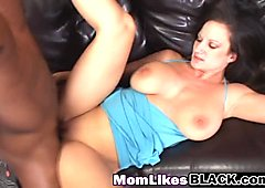 Busty milf takes huge black cock in cunt on couch