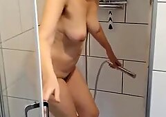 MILF shows big ass, mature tits & hairy cunt