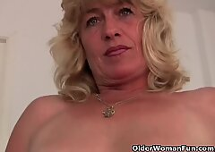 Granny gets her wet pussy fingered by the photographer