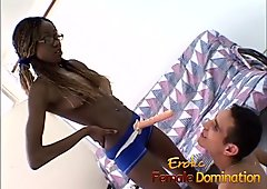 Skinny ebony dominatrix pegs a white slave until he cums