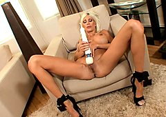 Puma Swede blonde babe on couch fingering her cunt