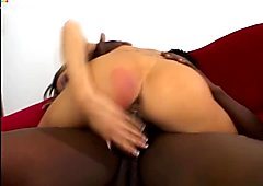 Slutty Tiffany Holiday rides a strong black dick on the couch
