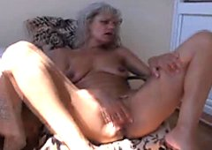 Old slut fingers her wet pussy with great enthusiasm