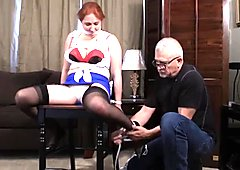 Sexy redhead tied up to a chair and teased