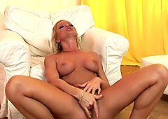 Big tit babe Sylvia Saint lies on the floor fingering her wer little pussy