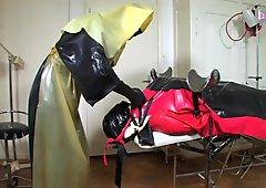 Bizarre rubber apron bondage 4 of 5