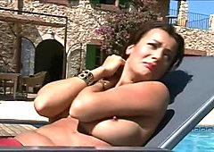 Relentless master torments his slave by the pool