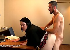 Secretary bent over the table