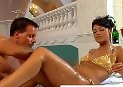 Clothed lady gets foot massage