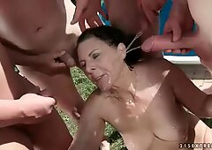 Five guys pissing on hot granny