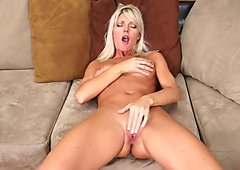 Smoking hot and sexy blonde milf babe takes off her clothes