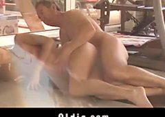 Redhead young girl sucks the old cock in the pool