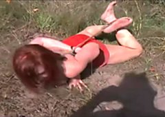 Nasty red head with tied up boobs is punished outdoor
